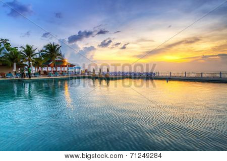 KOH KHO KHAO, THAILAND - 13 NOV 2012: Pool area of Andaman Princess Resort & SPA at sunset. Hotel was destroyed by tsunami in 2004 and rebuild, Koh Kho Khao, Phang Nga in Thailand.