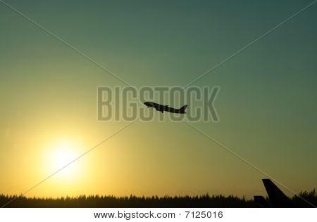 Orange Sunrise With Airplane Silhouette