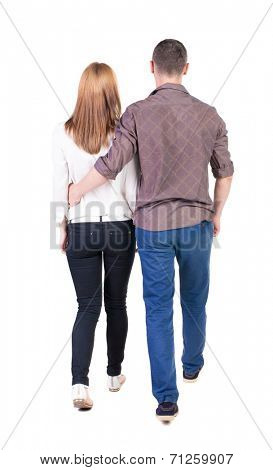 Back view going couple. walking friendly girl and guy holding hands. Rear view people collection. backside view of person. Isolated over white background.