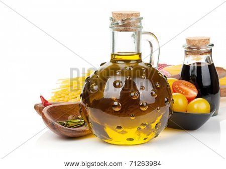 Olive oil, vinegar, tomatoes and pasta. Isolated on white background