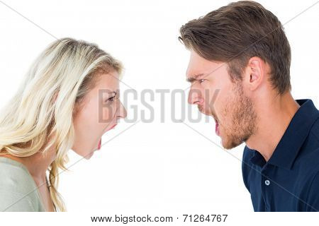 Angry couple shouting during argument on white background