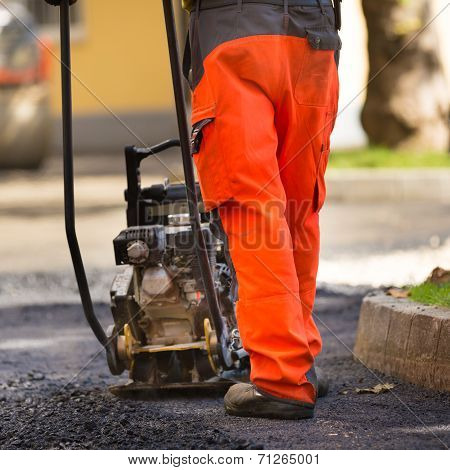 Asphalt surfacing manual labor.