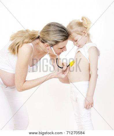 little girl with her pregnant mother and stethoscope