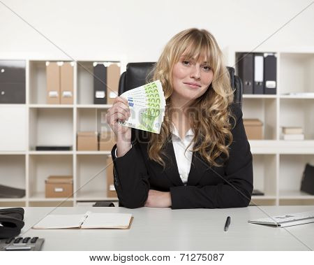 Successful Businesswoman Brandishing Money