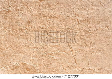 Ocher concrete wall textured background.