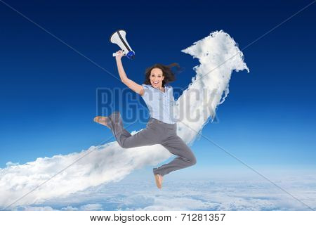 Cheerful classy businesswoman jumping while holding megaphone against cloud arrow