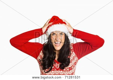 Irritated woman looking at camera on white background