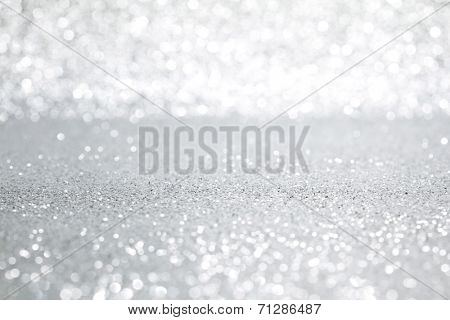 Shiny abstract silver defocused glitter background