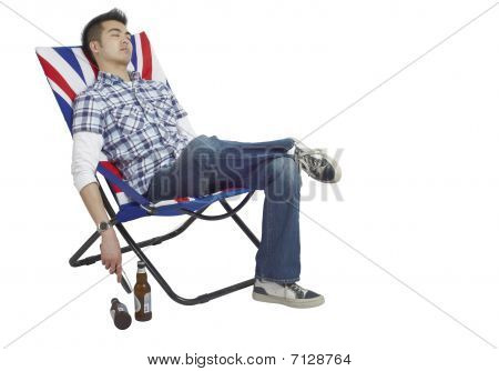 Sleeping man reclined in a chair