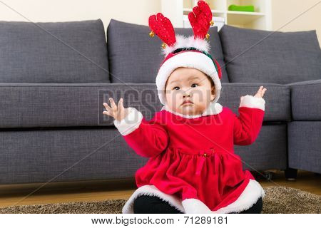 Little girl with christmas dressing
