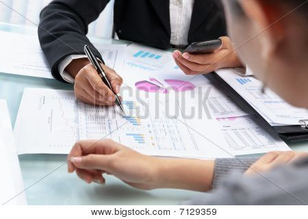 Businesswoman Working And Analyzing