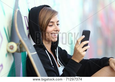Young Skater Happy Teen Girl Using A Smart Phone