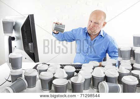 No more coffee for tired and sad businessman