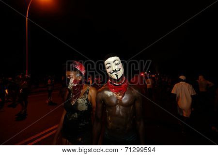Celebrant in Guy Fawkes mask