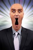 foto of keyholes  - Stressed businessman screaming with keyhole form mouth - JPG