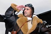 foto of bomber jacket  - WWII fighter pilot looking to the sky - JPG