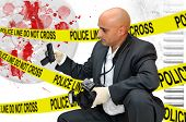 pic of crime solving  - Police CSI investigator with a camera holding a bag with a gun - JPG
