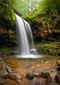 stock photo of backwoods  - Grotto falls Smoky Mountains waterfalls nature landscape using slow shutter for silky smooth waterfall effect - JPG