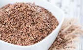 picture of flaxseeds  - Bowl with Linseeds (close-up shot) on vintage wooden background ** Note: Shallow depth of field - JPG