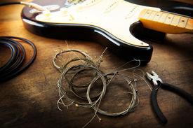 pic of string instrument  - Guitar maintenance - JPG