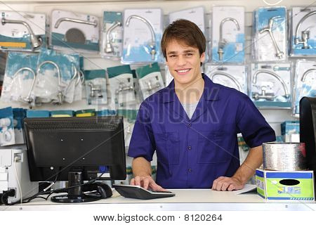 Portrait Of A Sales Assistant Behind The Counter