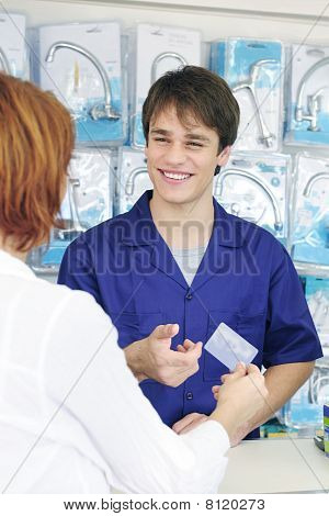 Sales Clerk Receiving  Credit Card  For Payment, Vertical