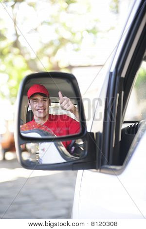 Delivery Courier In Van, Rear View Mirror