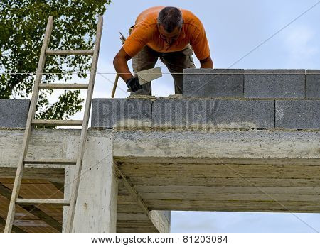 Mason performs an external masonry blocks