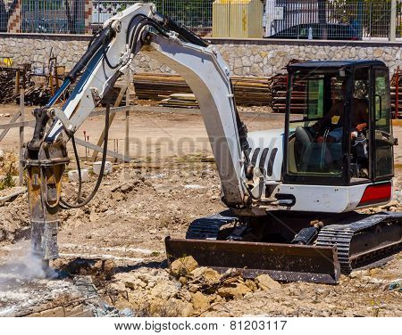 Excavator with demolition hammer