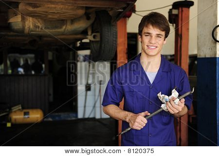 Car Mechanic At Work With Copy Space