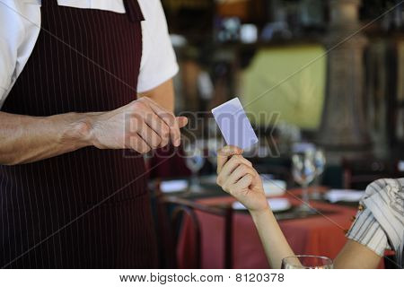 Customer Paying With Credit Card At The Restaurant