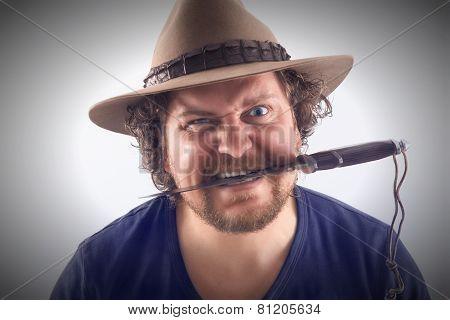 Mad Man With Knife Between Teeth