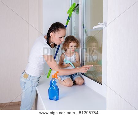 Family Washing Windows.