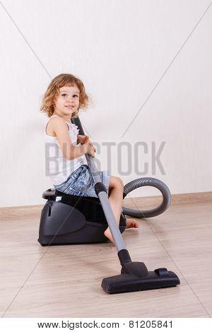 Child With Vacuum Cleaner.