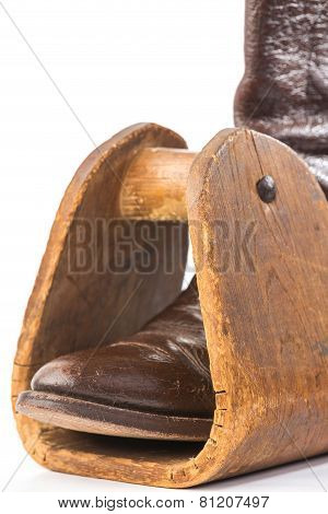 Cowboy Boot In Wooden Stirrup