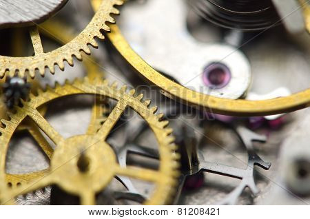 Background With Golden Metal Cogwheels Inside Clockwork