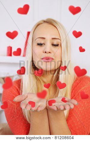 Woman Blowing On His Hand