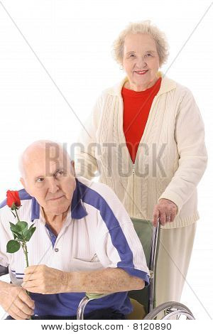 wife pushing elderly husband