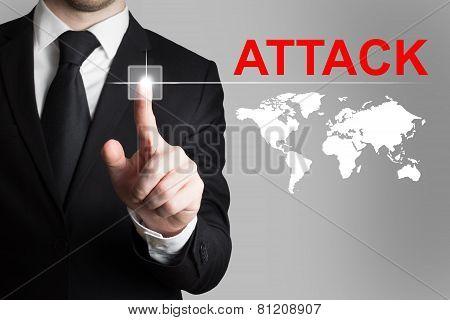 Businessman Pushing Button Attack International