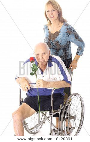 happy woman pushing handicap man