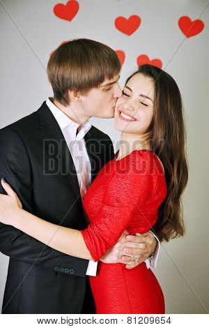 Man Kisses A Woman