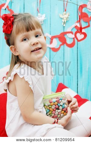 Girl With A Jar Of Candy