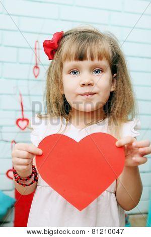 Girl Holding Heart In Hands