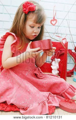 Girl Looks At A Gift