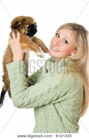 Young Woman Playing With A Pekinese