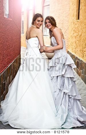 Young Bride And Bridesmaid In An Alleyway