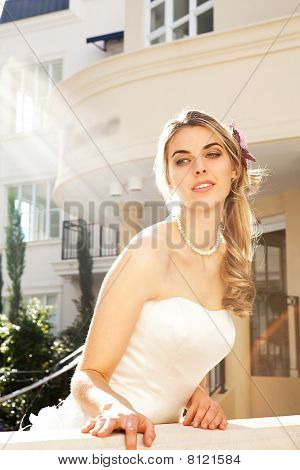 Young Bride Leaning Over Railing