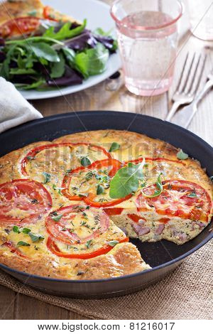 Frittata with vegetables and ham
