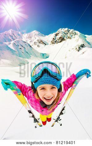Ski, winter vacation, snow, skier, sun and fun - girl enjoying ski vacations, filtered