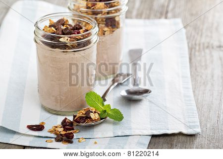 Chocolate smoothie with granola for breakfast